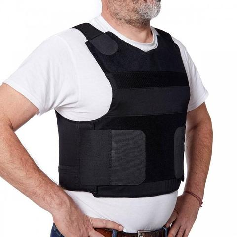 Man standing with a NIJ level II body armour vest on