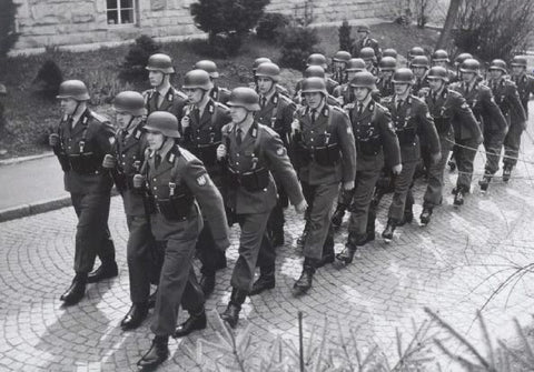 Black and white photo of the German military troops marching in 1950's