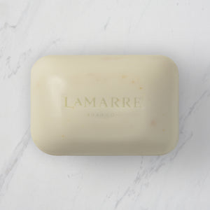 Lamarre Soap Co 5.3oz bar of Honey Almond Natural Bar Soap with exfoliating oatmeal, sweet almond essential oil, shea butter and coconut oil on marble counter.