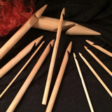 Twin Birch wooden crochet hooks on a black background