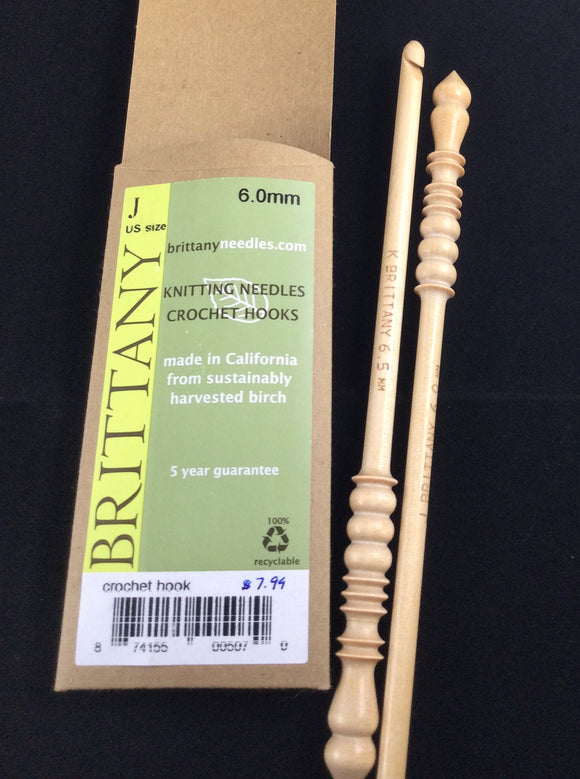 2 wooden Brittany crochet hooks with carved handles and Brittany packaging