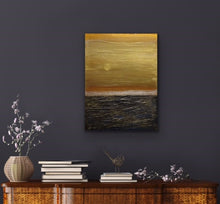 Load image into Gallery viewer, This pretty much depicts life don't you think. The sky is a beautiful gold but the seas are quite rough. The good and bad. The Yin and Yang. A thought provoking composition. I wanted to feel the roughness of the water so I used Venetian Plaster on a wood panel to get the rough texture and the sky is painted with high end metallic gold paint. If you look closely you'll see the sun breaking through...so there is a happy ending!