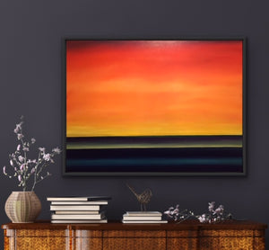 "Need a splash of colour in your room? This beauty is all about creating an understated splash. With its deep blue water and multiple shades of yellow and orange which are blended together imperceptibly, you can transform any room by providing a view of a beautiful summer sunrise over the lake.  This simple yet elegant image is a large 36""x48"" oil on canvas surrounded with a black floating frame."