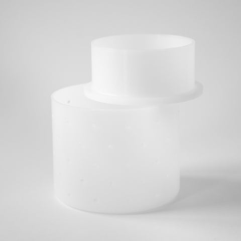 A white follower press for a cheese mould against a white background.