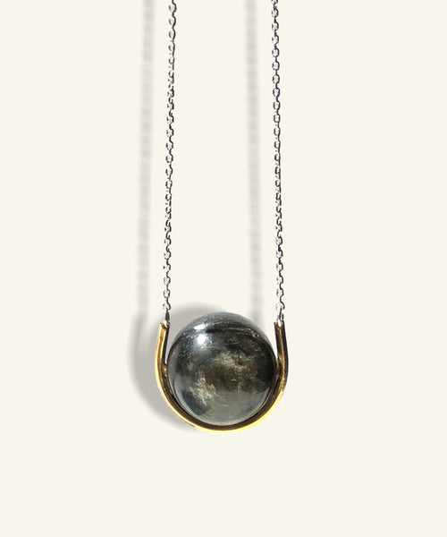 Golden Eye Sphere in Gold Cradle with Silver Chain