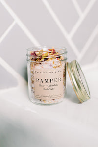 Herbal bath salts for pampering with rose petals and calendula