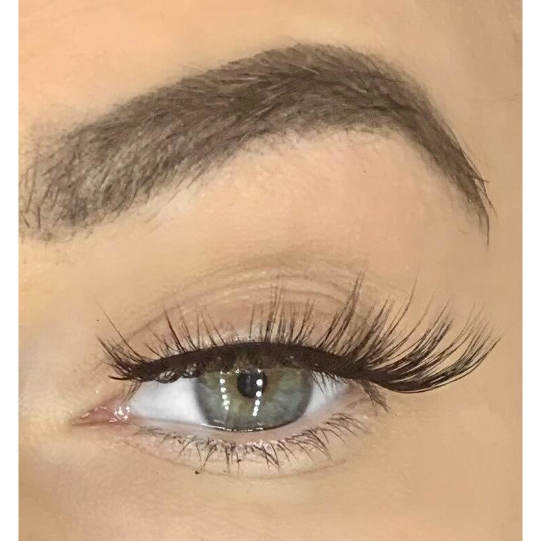 Woman wearing Level Up eyelashes - Glossed By Claire
