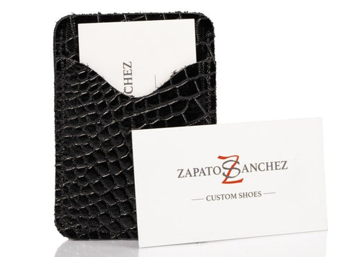 Hand made men's leather slim wallet built for style & utility. It has 2 discrete pockets.  Zapato Sanchez men's wallets will fit up to 10 cards, but once additional cards are added, the leather will conform to the extra cards added. But keep in mind, that once the leather stretches to conform to the cards, the leather will not return to its original shape.   Crafted in Canada at West Edmonton Mall, this everyday companion is a great gift for the man who appreciates and understated elegance.