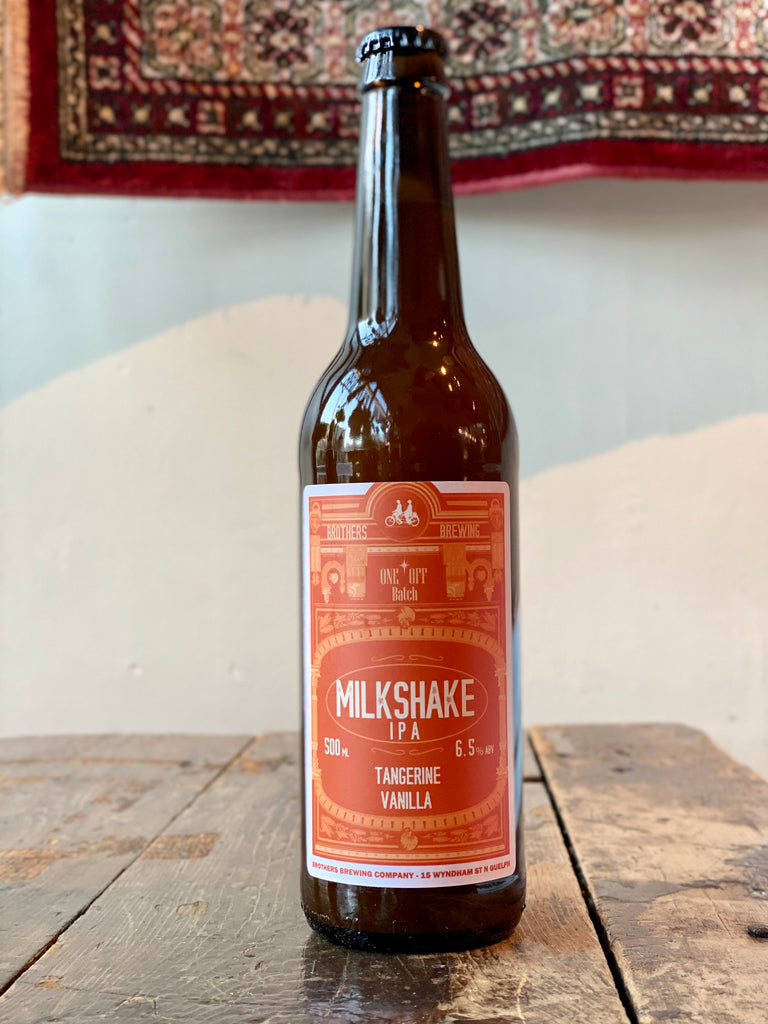Tangerine Milkshake IPA Bottle on Bar