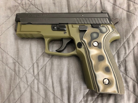 P228 with green frame, black slide, and camo grip