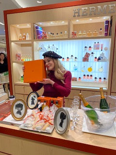 Cindi Rose doing silhouette art for Hermes around the USA