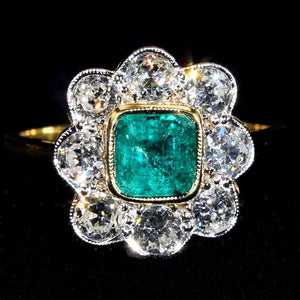 1960s Diamond Emerald Cluster Halo Ring 18 Karat Gold Platinum
