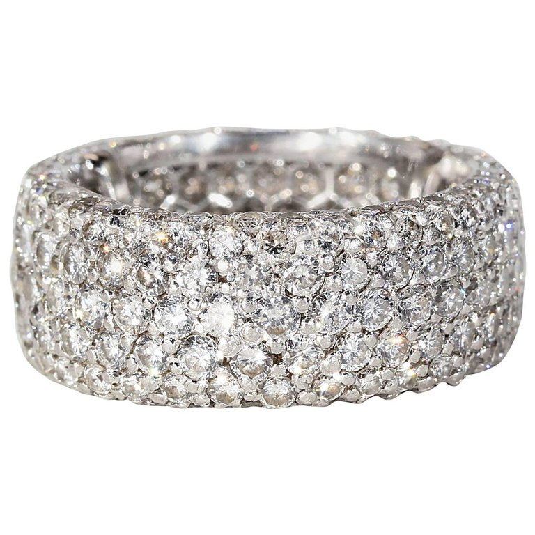 diamonds eternity in row tw showcasing betteridge three colorless ct co band shared of setting fine near rows link wide p platinum diamond bands ring prong round a