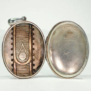 Victorian Embossed Silver Locket Button Design