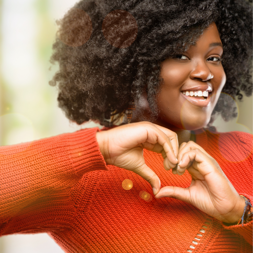A woman showing heart symbol