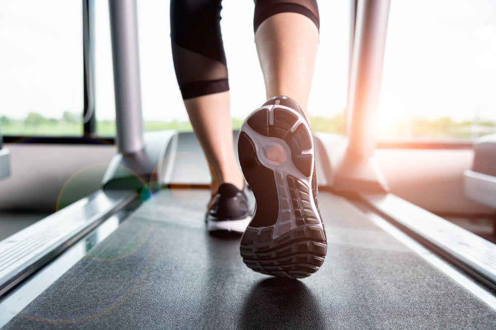 Close-up Of a Person Legs on a Treadmill