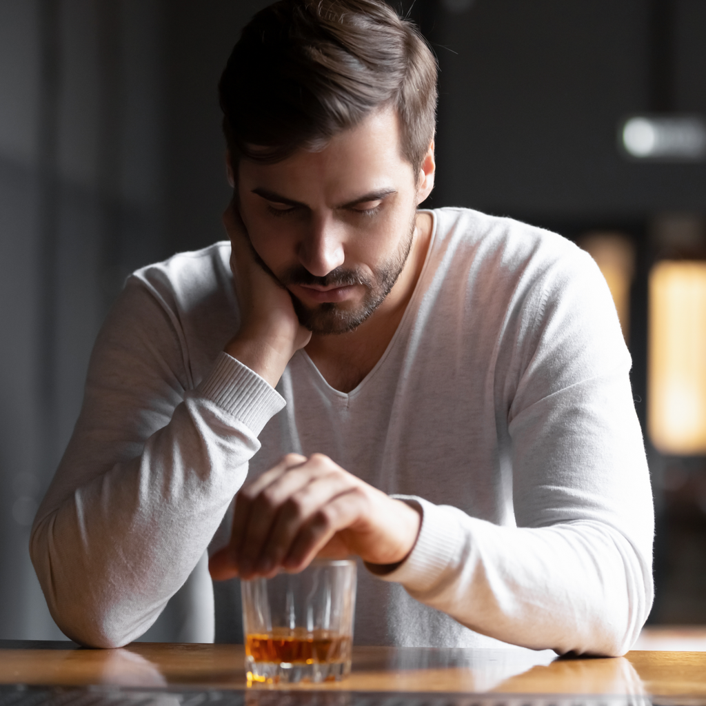 A man drinking whiskey