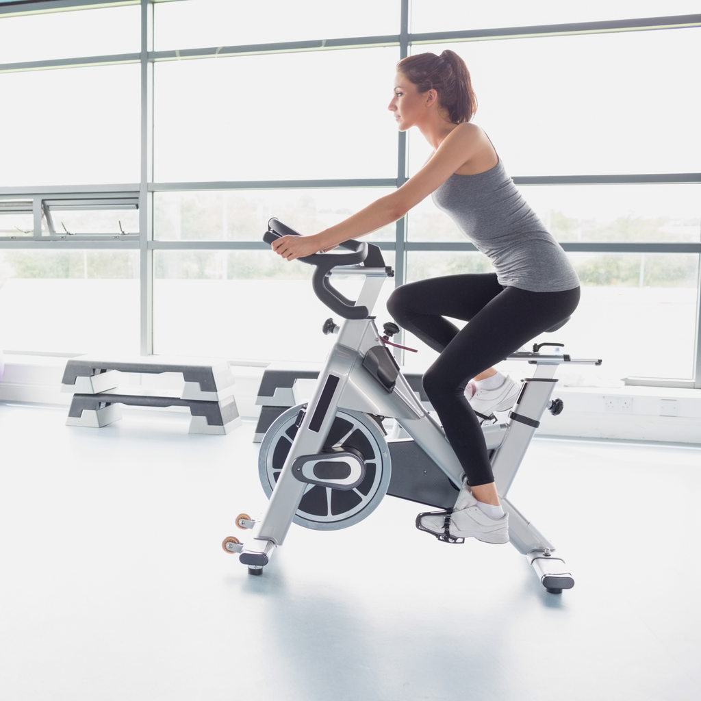 A woman doing exercise on a bike