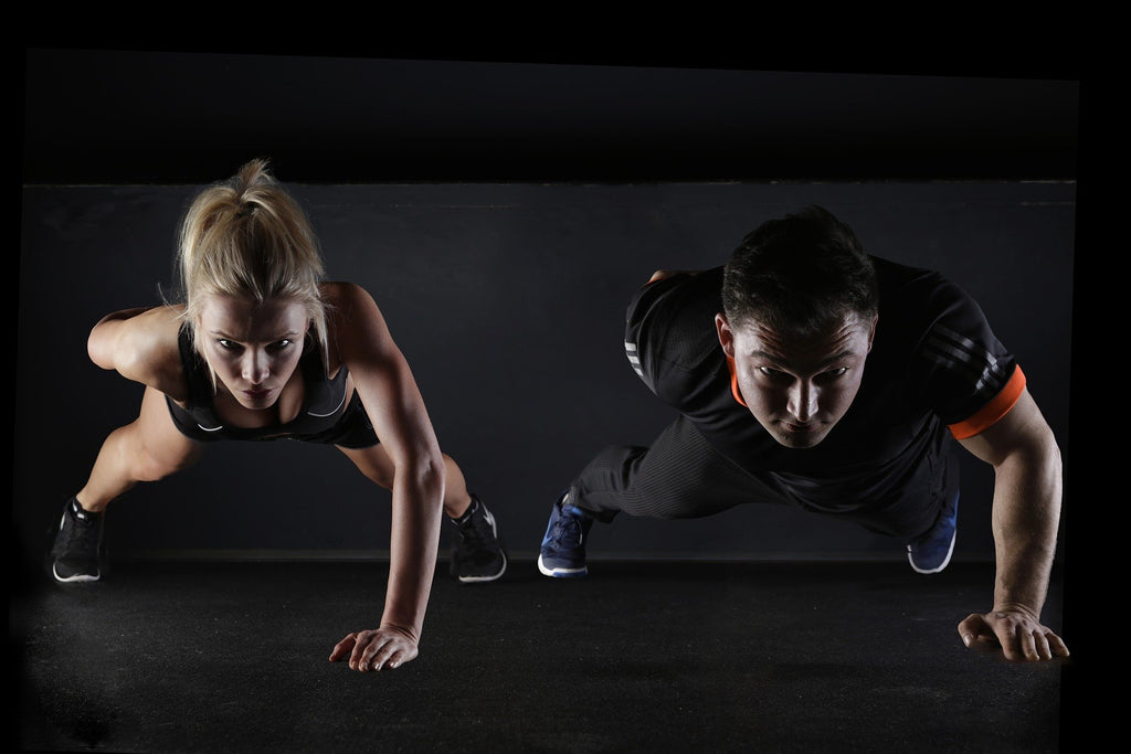 Two People Performing Single-Hand Push-Ups