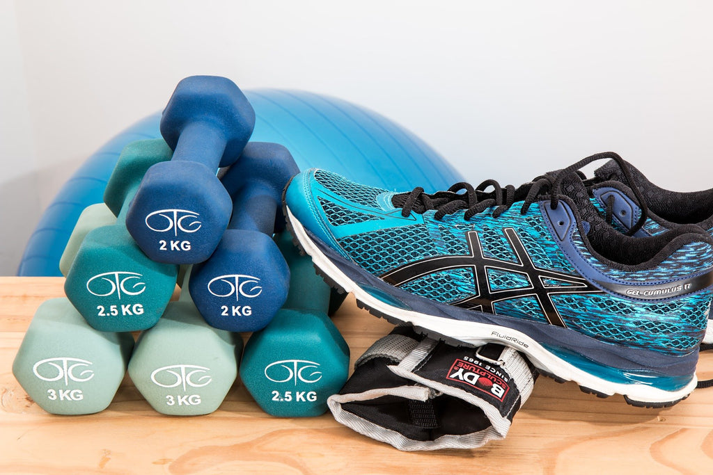 Dumbbells and Running Shoes on a Table