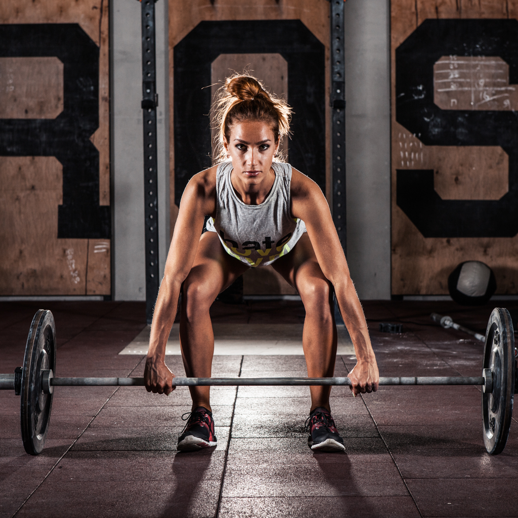 A Person Strength Training with a Barbell