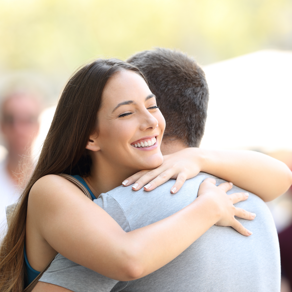 A Person Smiling While Hugging
