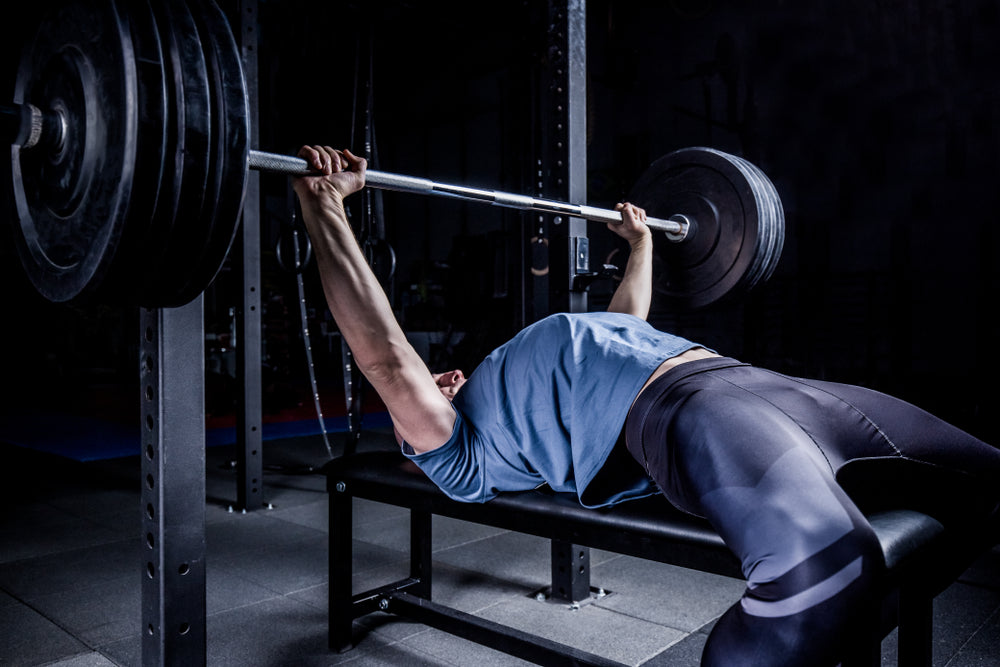 Person Pushing Up a Barbell