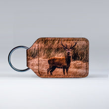 Load image into Gallery viewer, Leather keyrings featuring a classic Exmoor Stag
