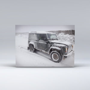 An Exmoor National Park Ranger's Landrover covered in snow and ice.