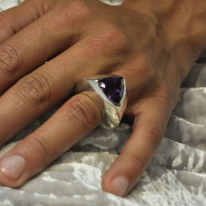 Wearing a triangular amethyst ring