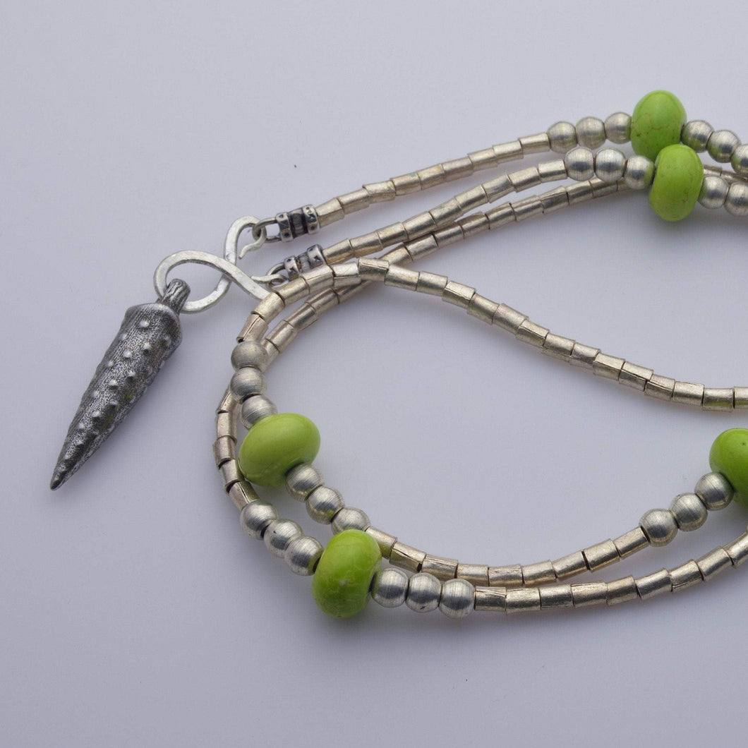 African beads with bullet iron pendant