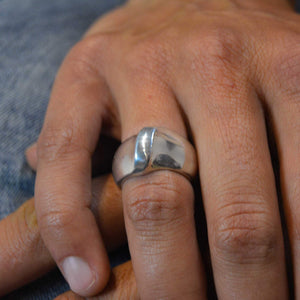 Large silver ring with unique form