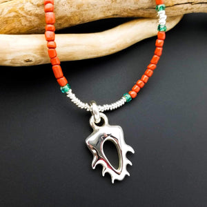 coral looking bead and silver pendant necklace