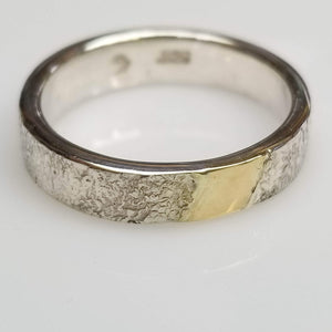 Hammered silver ring with gold inlay