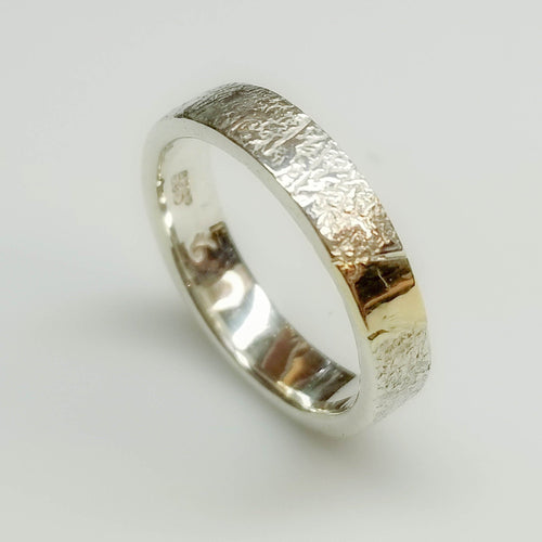 Textured silver with gold inlay band