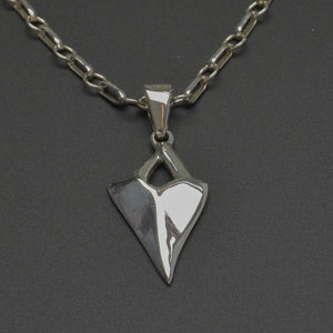 Highly polished silver shark tooth pendant