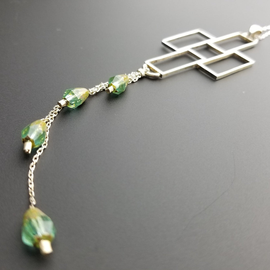 Emerald bead silver cross pendant