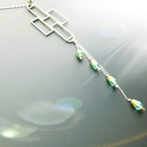 Crosses with dangling emerald color crystal beads