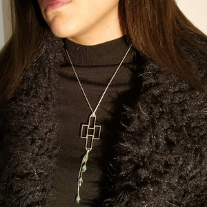 Silver chain necklace with rectangular pendant and emeralds