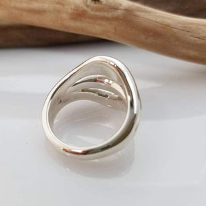 Dome sterling silver ring with three ridges on shank