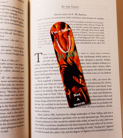 """Bookmark, """"Dragon's Fire"""", by Dragon Graphics from Dragon Market, on book pages"""