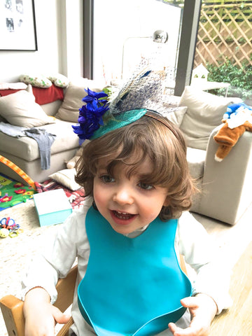 Step-brothers toddler wearing mum's fascinator