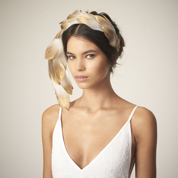 This Awon Golding Millinery sculptural veil is made from ivory tulle, ostrich quills, dramatic pheasant feathers, and gold ombr_ goose feathers.