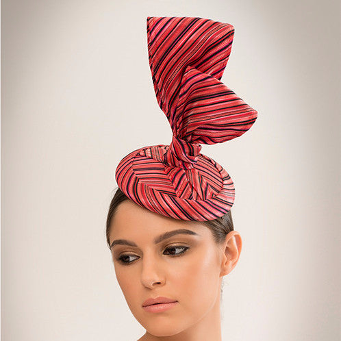 Tangkhul - This chic cocktail hat is made from delicate silk woven fabric bow on straw disc base.