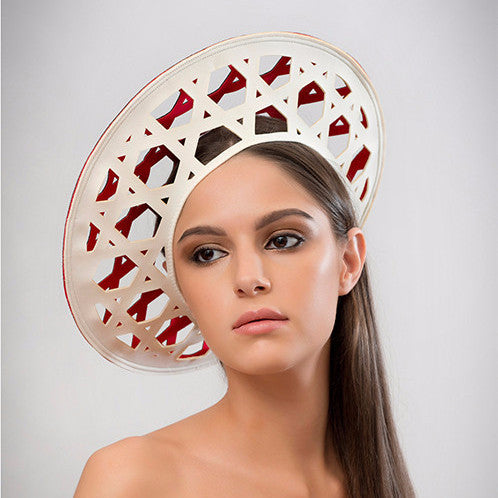 Konyak - This laser-cut two-tone neoprene beret is a chic addition to the modern woman's wardrobe. Best of all, it packs flat!