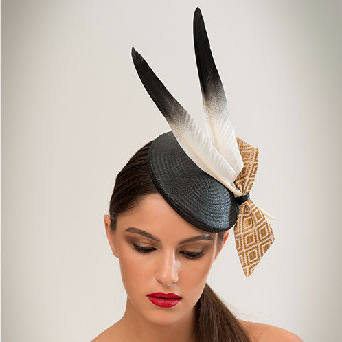 Ash - This black straw disc with goose feathers and geo-woven gold fabric bow is a crowd-pleaser that goes with almost anything.