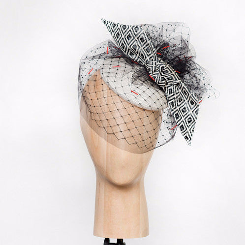 Rivers - White straw disc with geo-woven bow & hand-beaded tulle veil. This hat is both demure and modern.