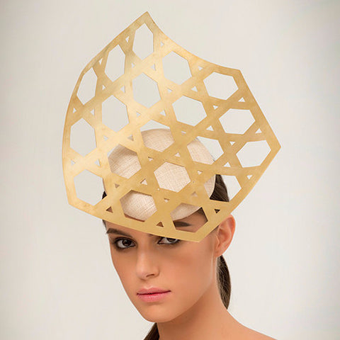 Kohima- Laser-cut geometric brass on pinokpok base. This is perfect for someone looking to make a bold, modern statement.