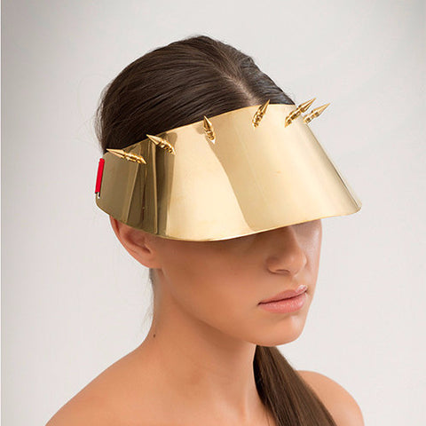 Kuki - Mirror polished brass visor with brass spike detailing. Sports luxe at its finest.