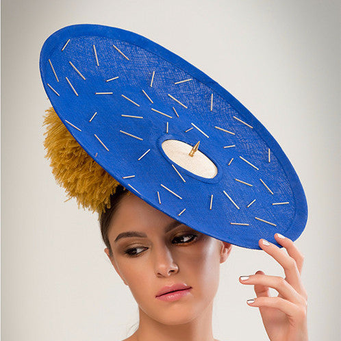 Pitt - Beaded cobalt pinokpok over-sized disc with gold bugle bead detailing, giant ostrich pom pom and single brass spike trim. The perfect Ascot hat.